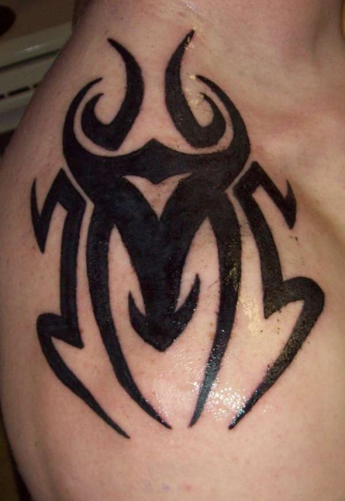 40 most popular tribal tattoos for men for Tattoo design in shoulder