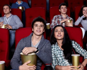 Young people are closely watching a movie at the cinema